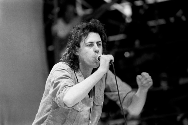 """BLACK AND WHITE ONLY File photo dated 13/07/1985 of Bob Geldof performing on stage during the Live Aid Concert at Wembley Stadium. PRESS ASSOCIATION Photo. Issue date: Wednesday July 14, 2010. Bob Geldof's battle to stage Live Aid after being inspired by the Ethiopian famine is to be turned into a TV film. When Harvey Met Bob is """"hilarious and deeply moving"""" drama about the Irish singer's collaboration with promoter Harvey Goldsmith to stage the global concert. See PA story SHOWBIZ Geldof. Photo credit should read: PA Wire"""